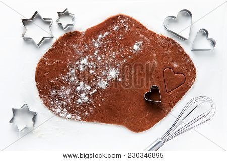 Dough For Chocolate Cookies  And Cookie Cutters In The Shape Of Hearts And Stars. Whisk. On White