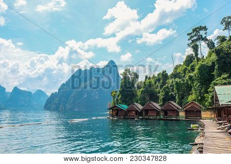 Wooden Thai Traditional Long-tail Boat On A Lake With Mountains And Rain Forest In The Background Du