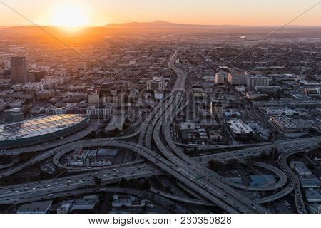 Aerial sunrise view of 10 and 110 freeway interchange ramps in downtown Los Angeles California.