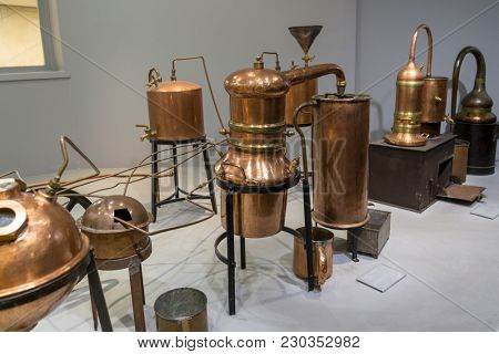 Paris, France, March 27 2017: Hall presentations perfume of the Museum Fragonard Distiller for the production of perfume water, the copper metal vat, a museum piece