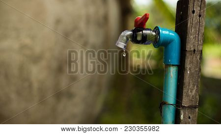 Pvc Faucet On Selective Focus. Tap Water In The Garden Beside The House.