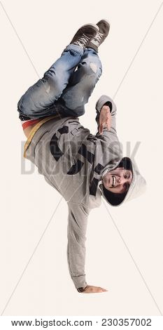 Funny cheerful happy man jumping in air over white background