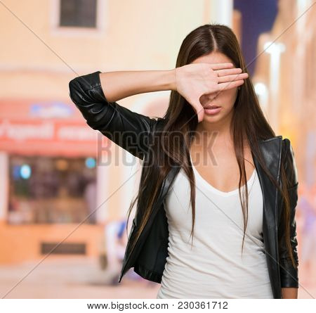Portrait of a Woman Covering Her Eyes, outdoor