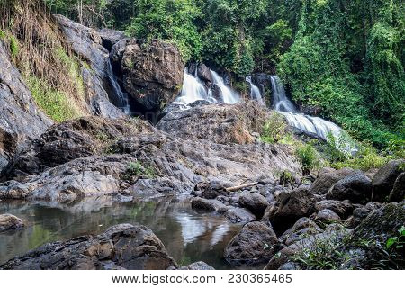 Long Exposure Picture Of Waterfall In The Forest, Blurred Motion Of Water (pha Suea National Park, T