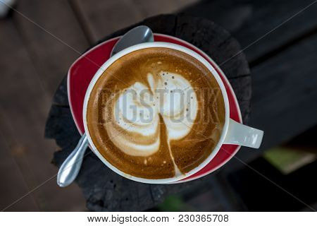 Hot Coffee In A Cup On A Plate Isolated On The Wood Table