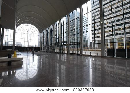 Willis Tower (formerly Sears Tower) Wacker Atrium Entrance, Large Glass Windows Reflecting On A Marb