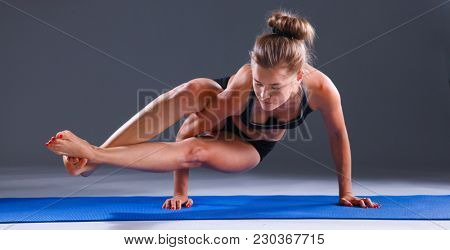 Portrait of sport girl doing yoga stretching exercise . yoga