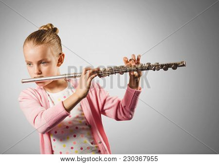 Digital composite of Girl against grey background playing the flute