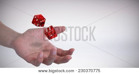 Hand of man pretending to hold an invisible object against grey background
