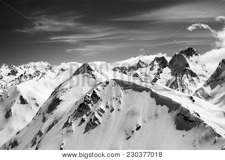 Black And White Winter Mountains With Snow Cornice And Sky With Clouds In Cold Sun Day. Caucasus Mou