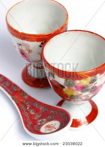 Two tea cups and spoon painted from China
