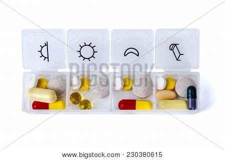 Dietary Supplement In Storage Case - Closeup On Wooden Board