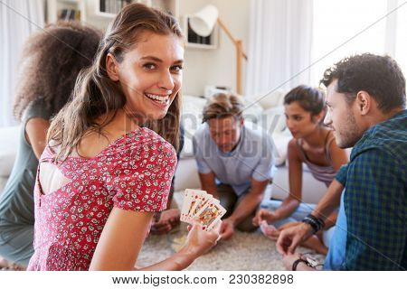 Portrait Of Friends At Home Playing Cards Together