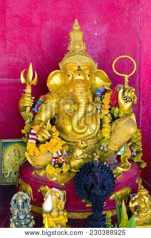 Gold Sculpture Of God Ganesha With The Head Of An Elephant. Thailand.