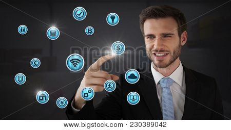 Digital composite of Businessman touching various business icons