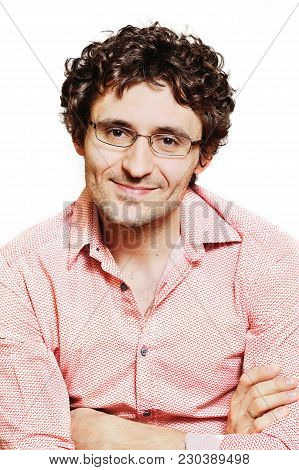 Young Handsome Guy With Curly Hair Wearing Glasses For Vision On A White Background