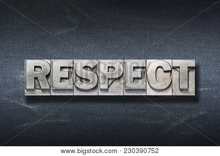 Respect Word Made From Metallic Letterpress On Dark Jeans Background