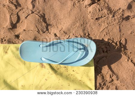 Beach Sand On Which There Is A Woman Pool Flip-flop