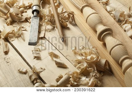 Carpentry Concept.joiner Carpenter Workplace. Old Chisel, Pencil And Wooden Workpiece On The Table.