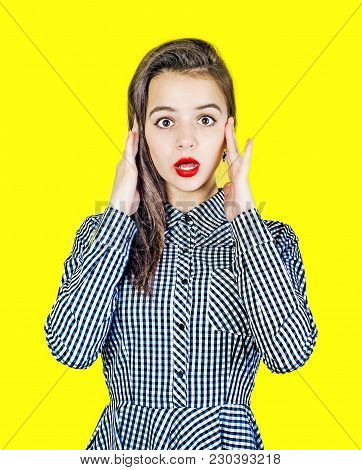 Portrait Of A Surprised Charming Pinup Girl With A Mouth Open On A Yellow Phone