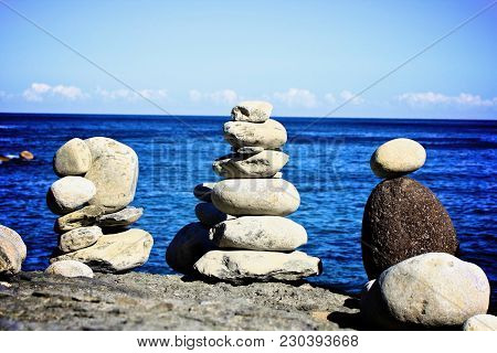 Ceremonial Rock Formation Overlooking The Sea Between South Korea And Japan.  Each Rock Represents A