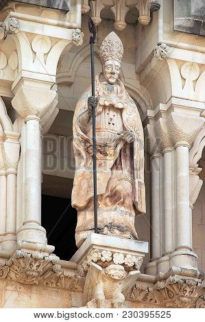 An Julian Patron Of The City, Poses On A Pedestal On The Facade Of The Cathedral