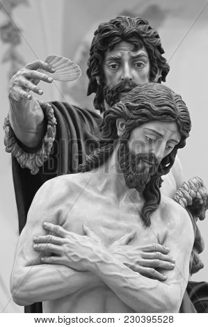 Jesus Christ Is Baptized By Saint John The Baptist According To The Representation In A Step Of Holy