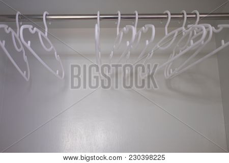 Close Up Of White Plastic Clothes Hangers