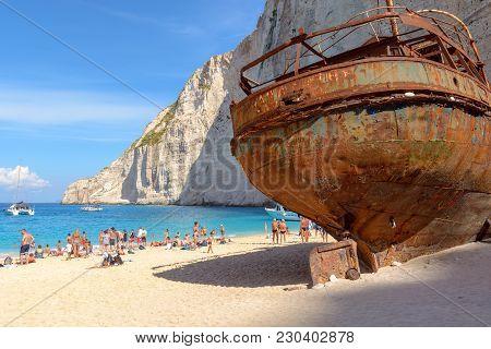 Zakynthos, Greece, September 27, 2017: Tourists Enjoying A Summer Day On Navagio Beach With Shipwrec