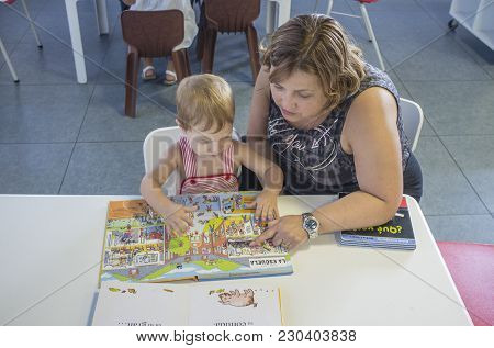 Badajoz, Spain - September 5th 2017: Adorable 2 Years Boy Discovering Pop-up Book Stories With His A