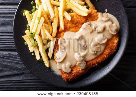 Crispy Fried Pork Chops (jaeger Schnitzel) With Sauce And French Fries Close-up. Horizontal Top View