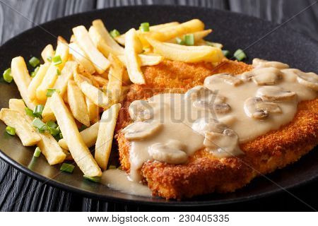 Delicious Wiener Hunter Schnitzel With Sauce And French Fries Close-up. Horizontal