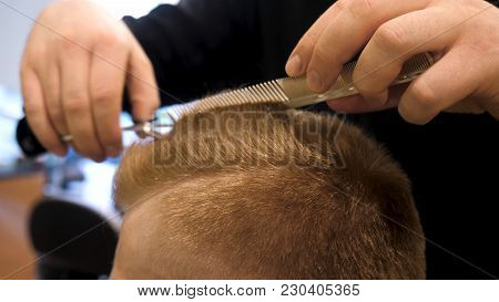 Close Up Of Men's Hair Cutting Scissors In A Beauty Salon. Master Cuts Hair And Beard Of Men In The