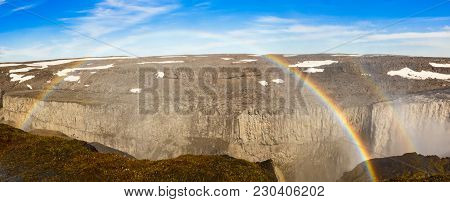 Dettifoss Waterfall Canyon With Bright Double Rainbow Arc, Vatnajokull National Park In Northeast Ic