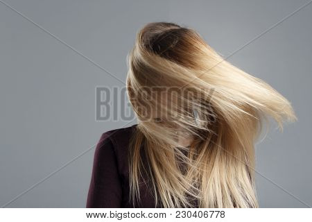 A Girl With Very Well-groomed Hair Has Fun At The Camera And Wags Her Head, A Good Mood, Abstract Ph