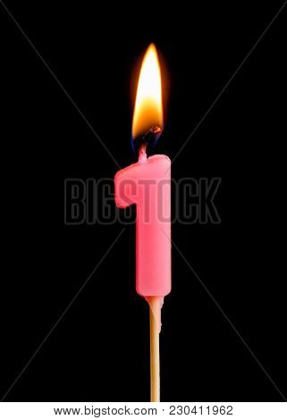 Burning Candle In The Form Of One Figures (numbers, Dates) For Cake Isolated On Black Background. Th