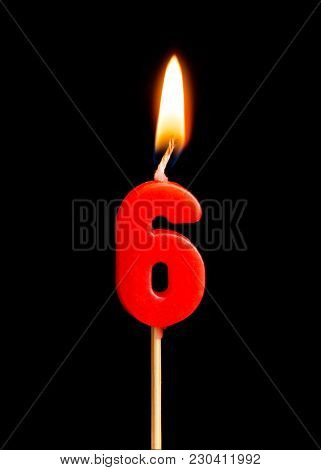 Burning Candle In The Form Of Six Figures (numbers, Dates) For Cake Isolated On Black Background. Th