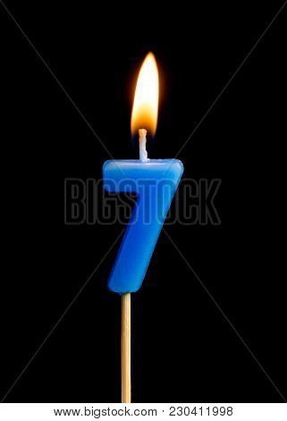 Burning Candle In The Form Of Seven Figures (numbers, Dates) For Cake Isolated On Black Background.