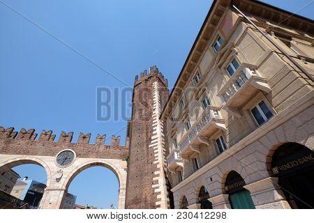VERONA, ITALY - MAY 27: Corso Porta Nuova street and medieval Gates Portoni della Bra on Piazza Bra in Verona, Italy, on May 27, 2017.