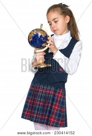 Little Girl Looks At The Globe. The Concept Of Science And Geography, A Happy Childhood. Isolated On