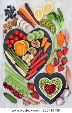 Super food for healthy life concept with fresh vegetables, fruit, nuts and spices with foods high in  anthocyanins, antioxidants, omega 3 fatty acids, dietary fibre, vitamins and minerals. Top view.