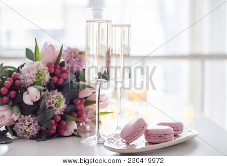 Beautiful Wedding Decoration With Champagne And Pink Flowers, Elegant Decor With Wine Glasses And Ma