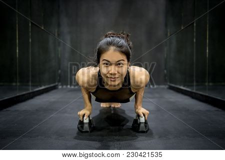Young Asian Athlete Woman Doing Push Up With Push-up Bars On The Floor, Sport And Training In Fitnes