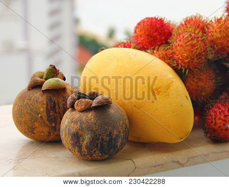 Juicy Ripe Fruit, Yellow Mango, Hairy Rambutan, Mangosteen With Maroon Skin, Composition For Smoothi