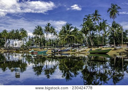 Image Of Group Of Fisherman Boat Under Bright Sunny Day