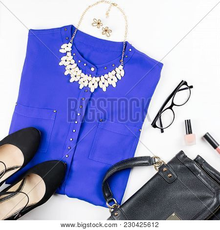 Female Smart Casual Style Clothing, Cosmetics And Accessories Flat Lay. Top View