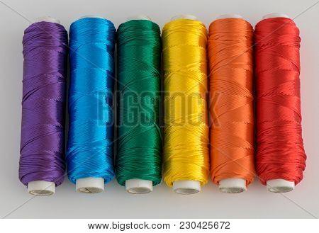 Rainbow Flag. Lgtb Symbol Made With Colorful Spools Of Thread.