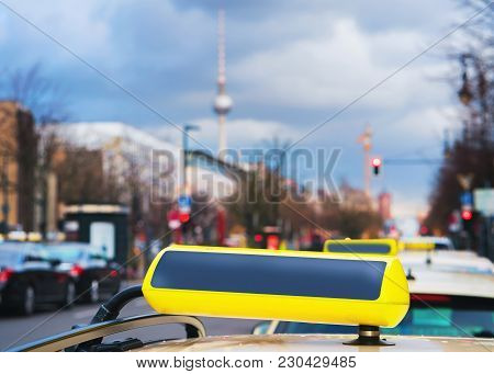 Empty Taxi Sign Board On The Street Of Berlin, Germany. Television Tower On The Background