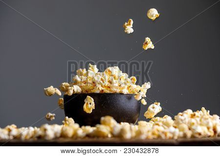 Levitating Falling Popcorn In A Ceramic Bowl And Around It.