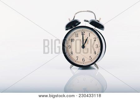 Closeup  Vintage Alarm Clock For Time Management Concept